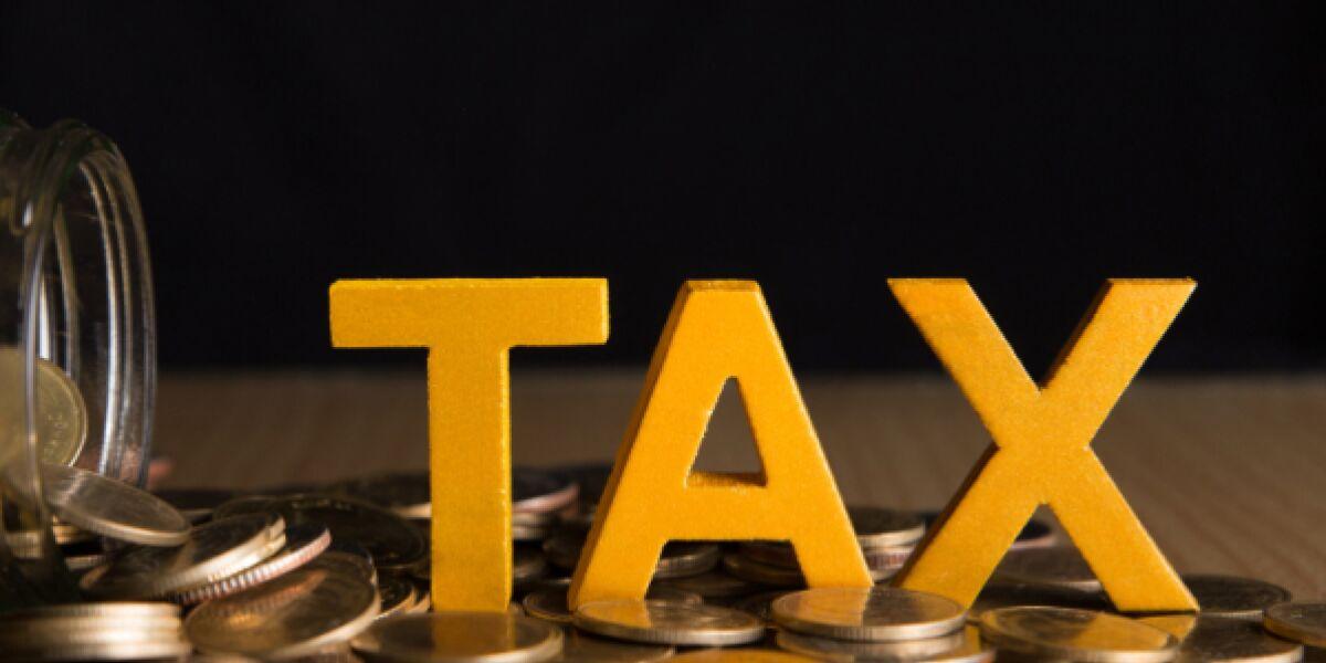 Tax-Buchstaben auf Kleingeld