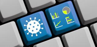 Diagramm und Covid-19-Symbol auf der 3D-Tastatur