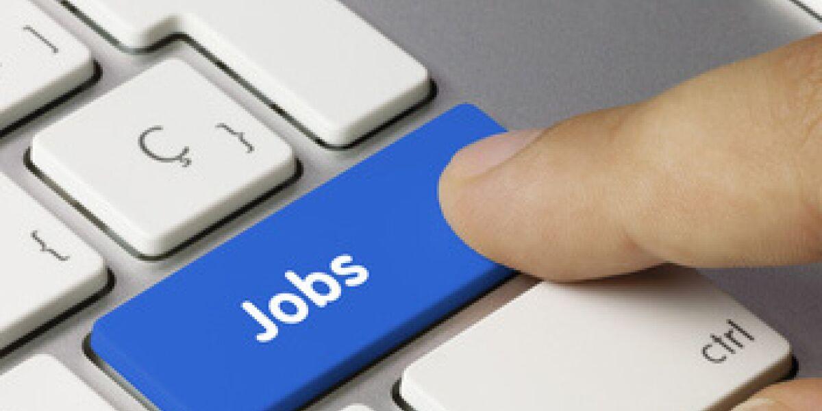 Blaue Jobs Taste am Computer