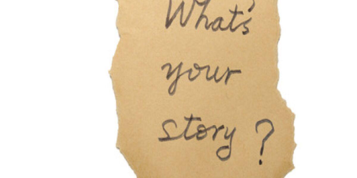 Zettel mit Aufschrift whats your story?