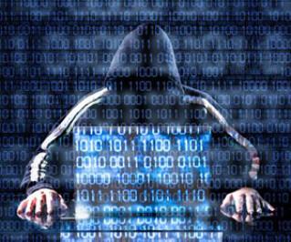 Hacker sitzt vor Laptop