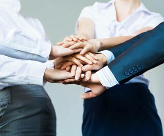 Teamwork Hände gemeinsam