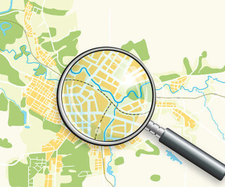 Landkarte mit Lupe