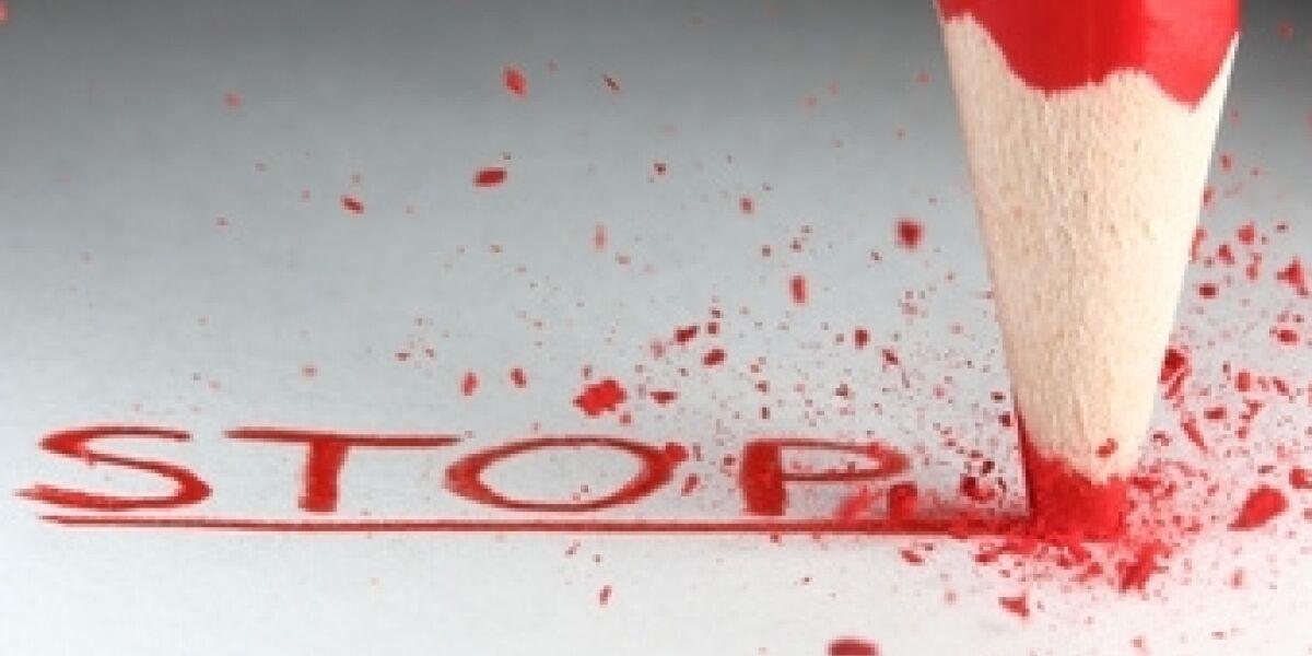 Stift schreibt Stop