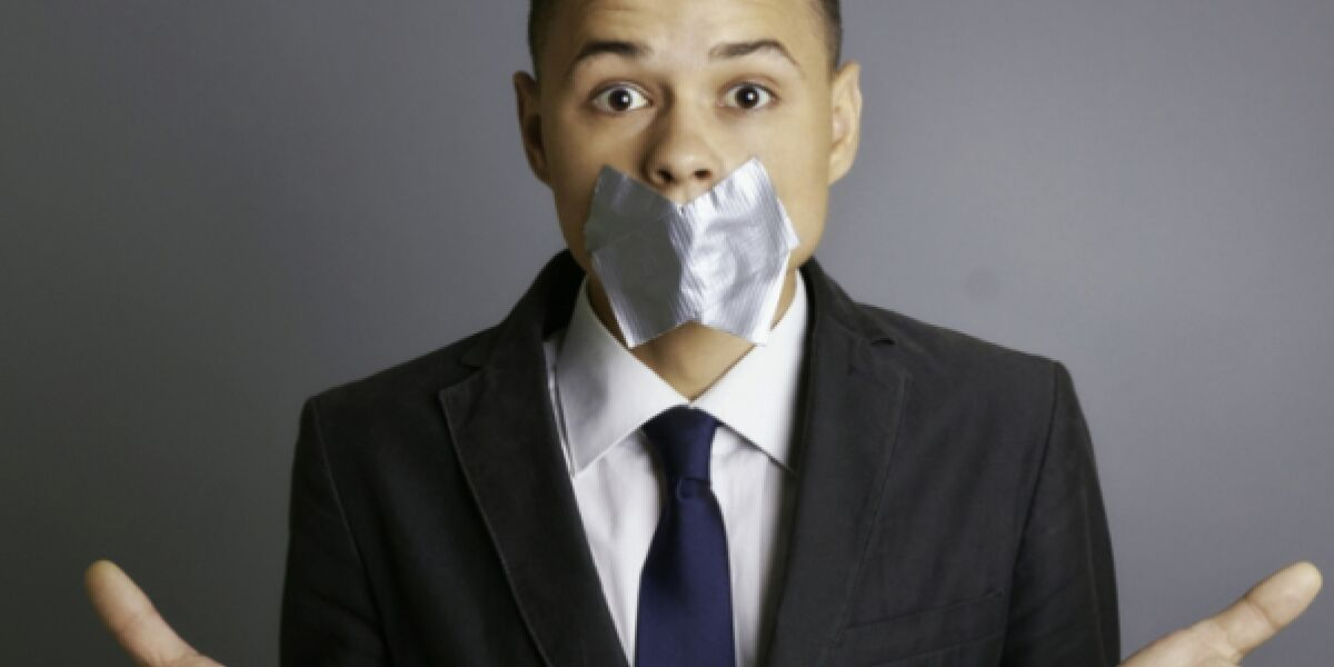 Businessman with silver tape over his mouth