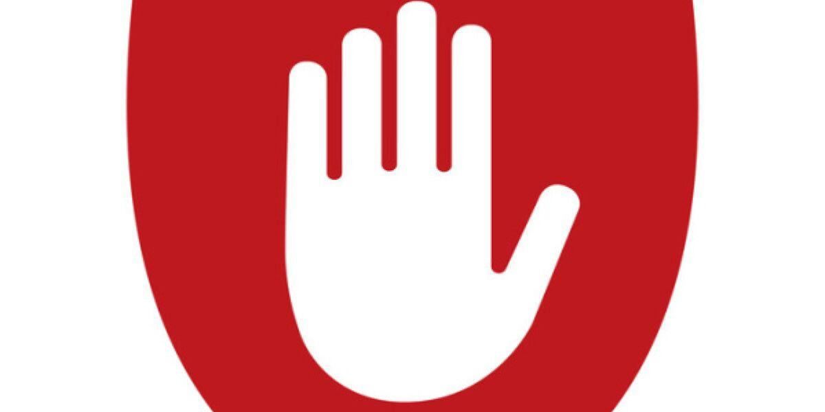 Hand auf rotem Schild