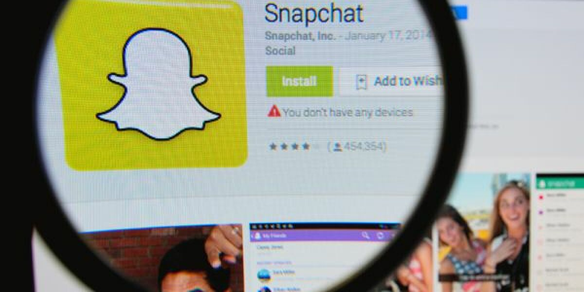 Snapchat-Webseite mit Lupe