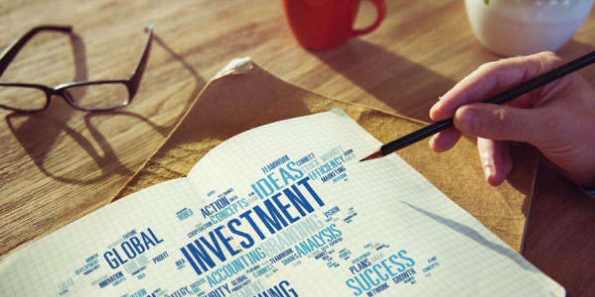 Investment steht auf einem Zettel