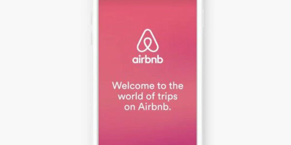 Smartphone mit Airbnb-Werbung