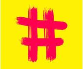 Pinkes Hashtag Symbol vor gelbem Hintergrund