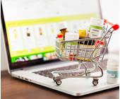 Einkaufswaagen auf einem Laptop